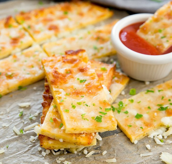 Flourless Low Carb Cheese Breadsticks with marinara dipping sauce on the side