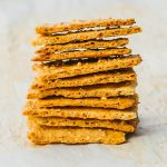 Big stack of low carb crackers made with parmesan cheese and almond flour