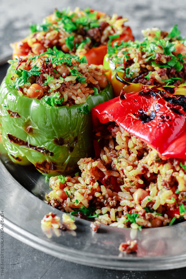Stuffed Bell Pepper Recipe with Rice, Spiced Ground Beef and Chickpeas. A delicious Mediterranean twist on stuffed bell peppers! Simple recipe with step-by-step photos.