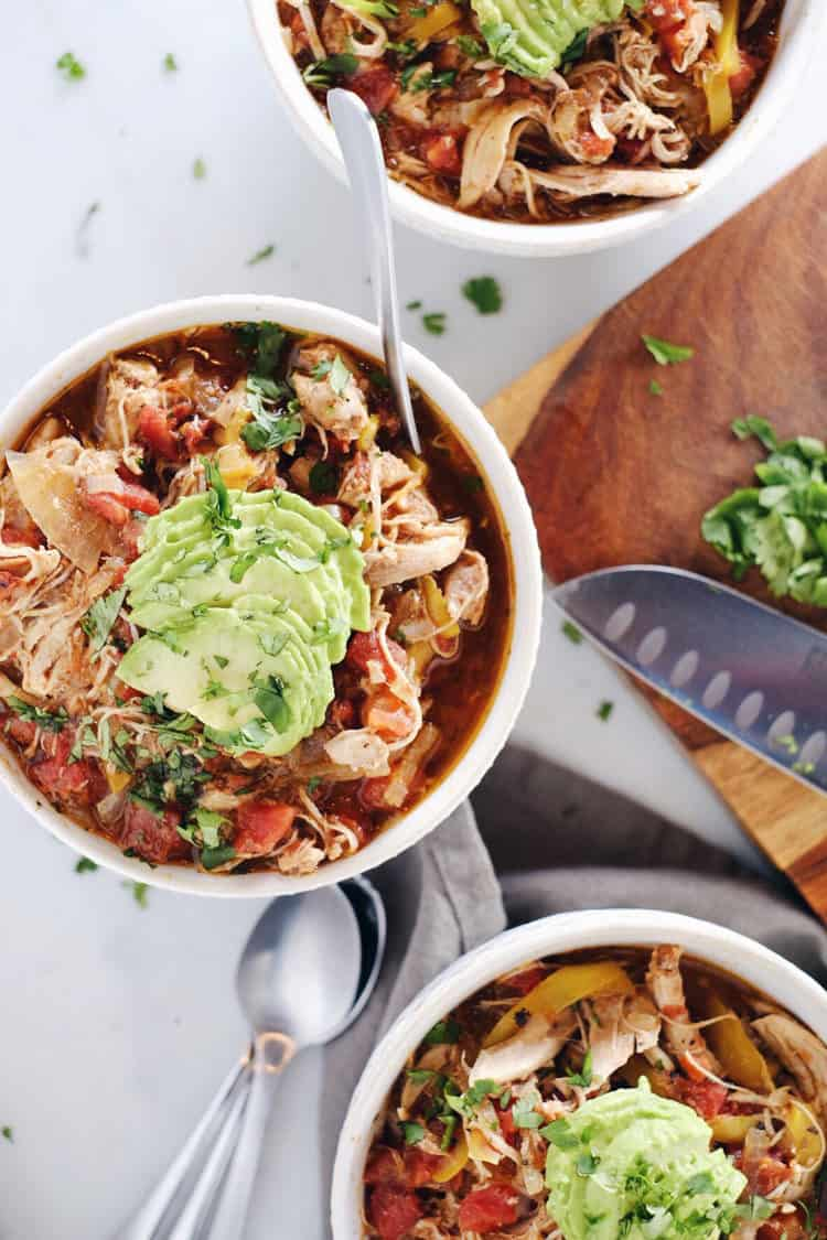Crockpot Chicken Enchilada Soup overhead three bowls