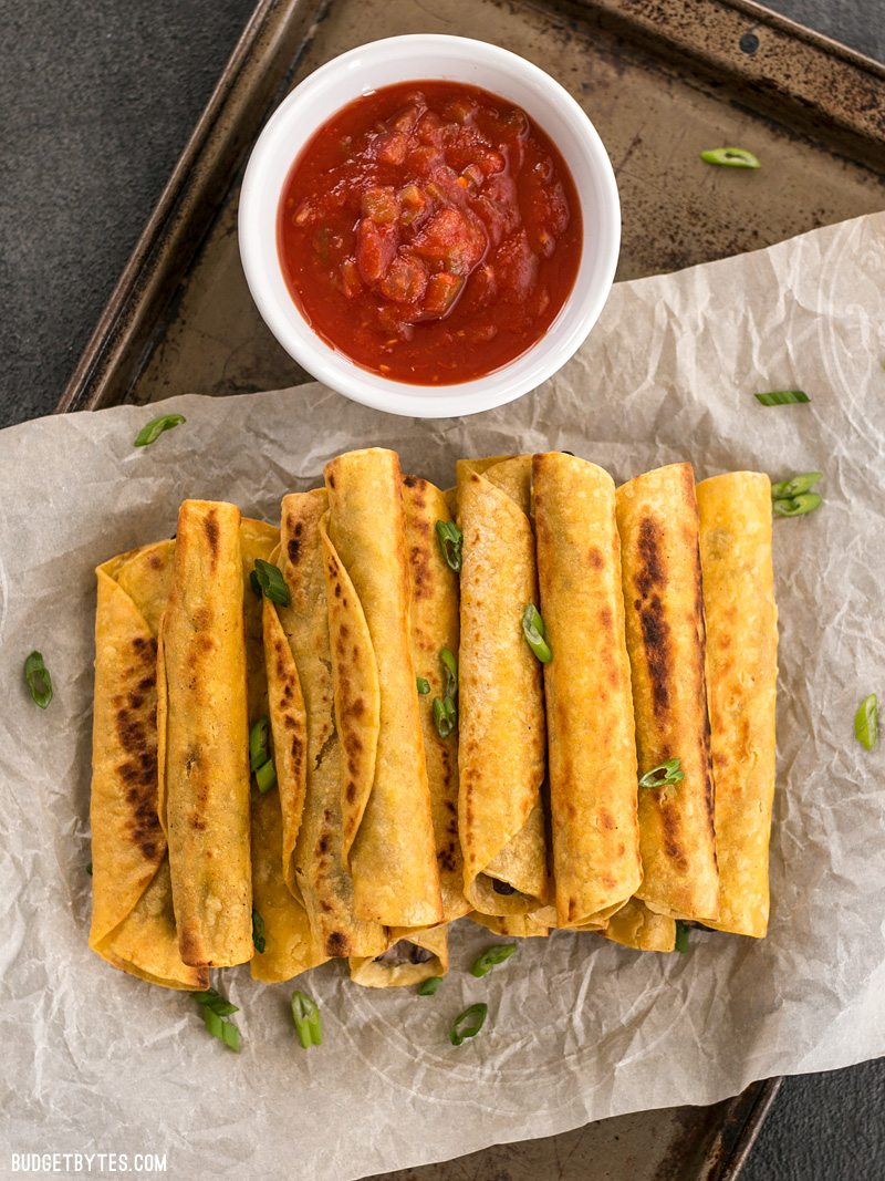 Creamy Black Bean Taquitos are an easy and tasty party treat for football games or just for fun! BudgetBytes.com