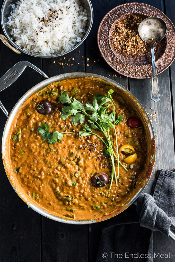 This easy to make Creamy Coconut Lentil Curry takes only 30 minutes to make and is packed full of delicious Indian flavors. It's a healthy vegan recipe that makes a perfect meatless Monday dinner recipe. Make extras any you'll have a giant smile on your face at lunch the next day. | theendlessmeal.com
