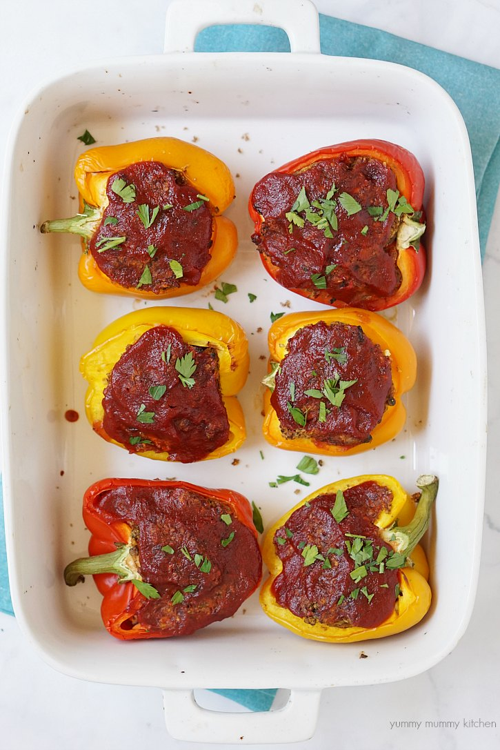 Vegan stuffed peppers made out of lentil meatloaf.