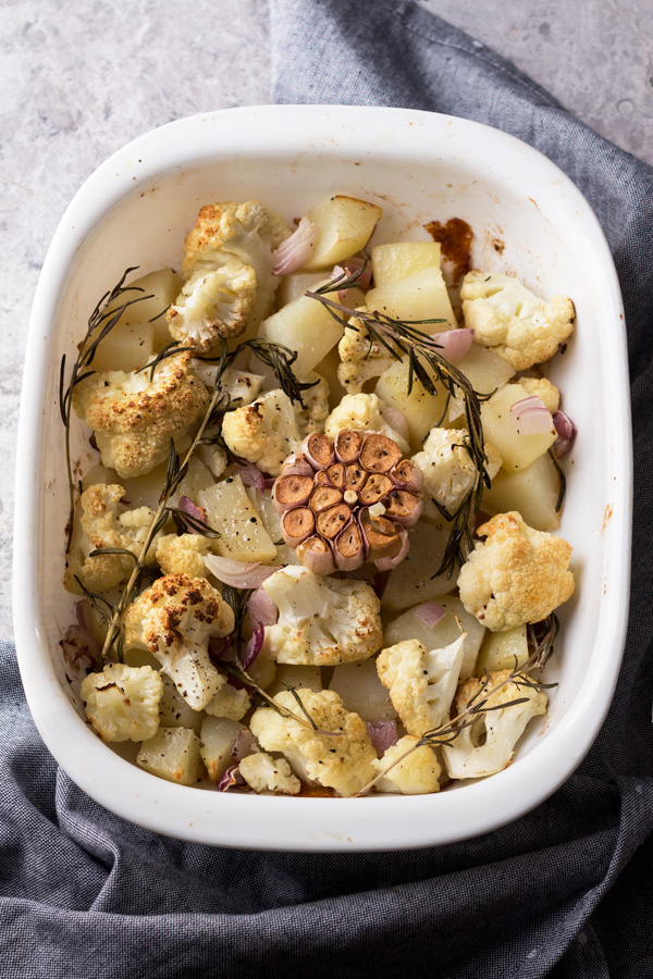 This cheesy vegan cauliflower potato soup is creamy, filling and bursting with flavour. It's also gluten-free, Whole30 approved and required just 1 hour and 10 ingredients. It's the perfect vegan soup for warming up on cold winter days   ExSloth.com