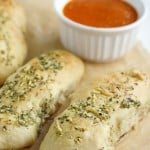 Easy to make homemade fluffy breadsticks with marinara sauce. These are delicious and kid friendly!