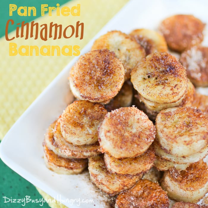 Overhead view of pan fried cinnamon banana rounds on a white plate