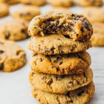 Tall stack of best low carb chocolate chip cookies, one with a bite taken out