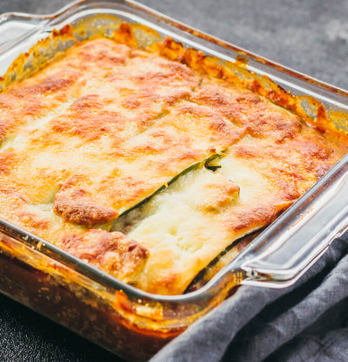 keto zucchini lasagna in baking dish immediately after roasting with a golden brown cheesy surface