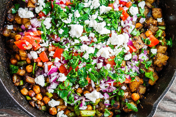 Mediterranean Potato Hash Recipe | The Mediterranean Dish. An easy breakfast hash with potatoes, chickpeas, asparagus, tomatoes and Mediterranean spices and fresh herbs. Comes together in less than 30 mins. See the step-by-step today on The Mediterranean Dish.
