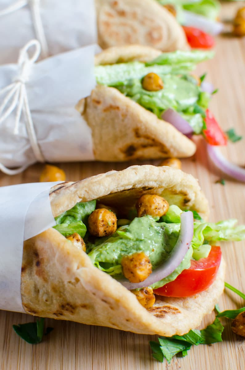 Naan bread vegan wraps filled with toasted chickpeas. This wrap is healthy and filling. No naans... then replace with pita or soft tacos.