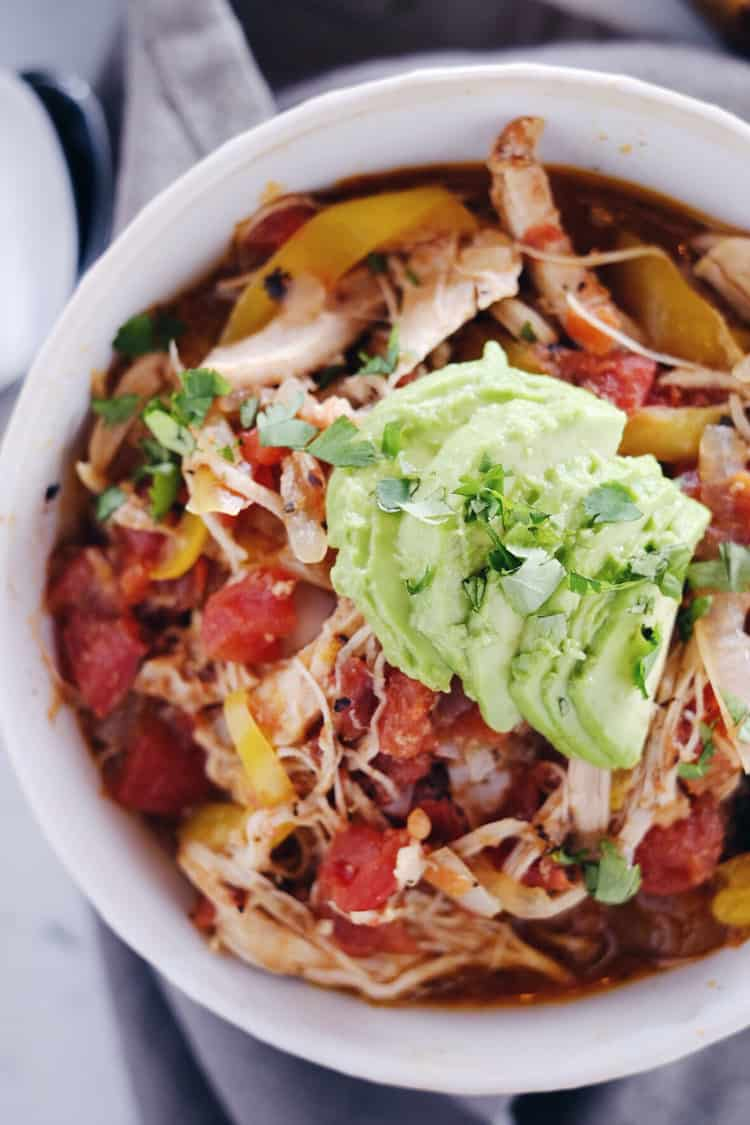 Crockpot Chicken Enchilada Soup overhead one bowl close up