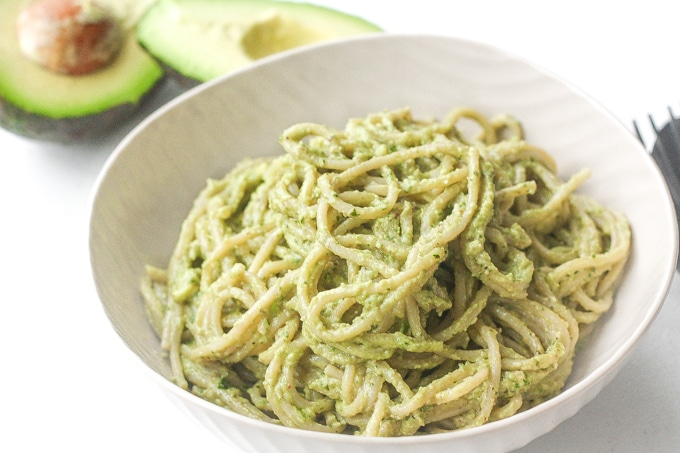 Creamy Avocado Basil Pesto Spaghetti: Treat yourself to the easiest vegan and super creamy avocado basil pesto spaghetti tonight. Ready in 10 minutes, you won't know what do with your free time! | aheadofthyme.com