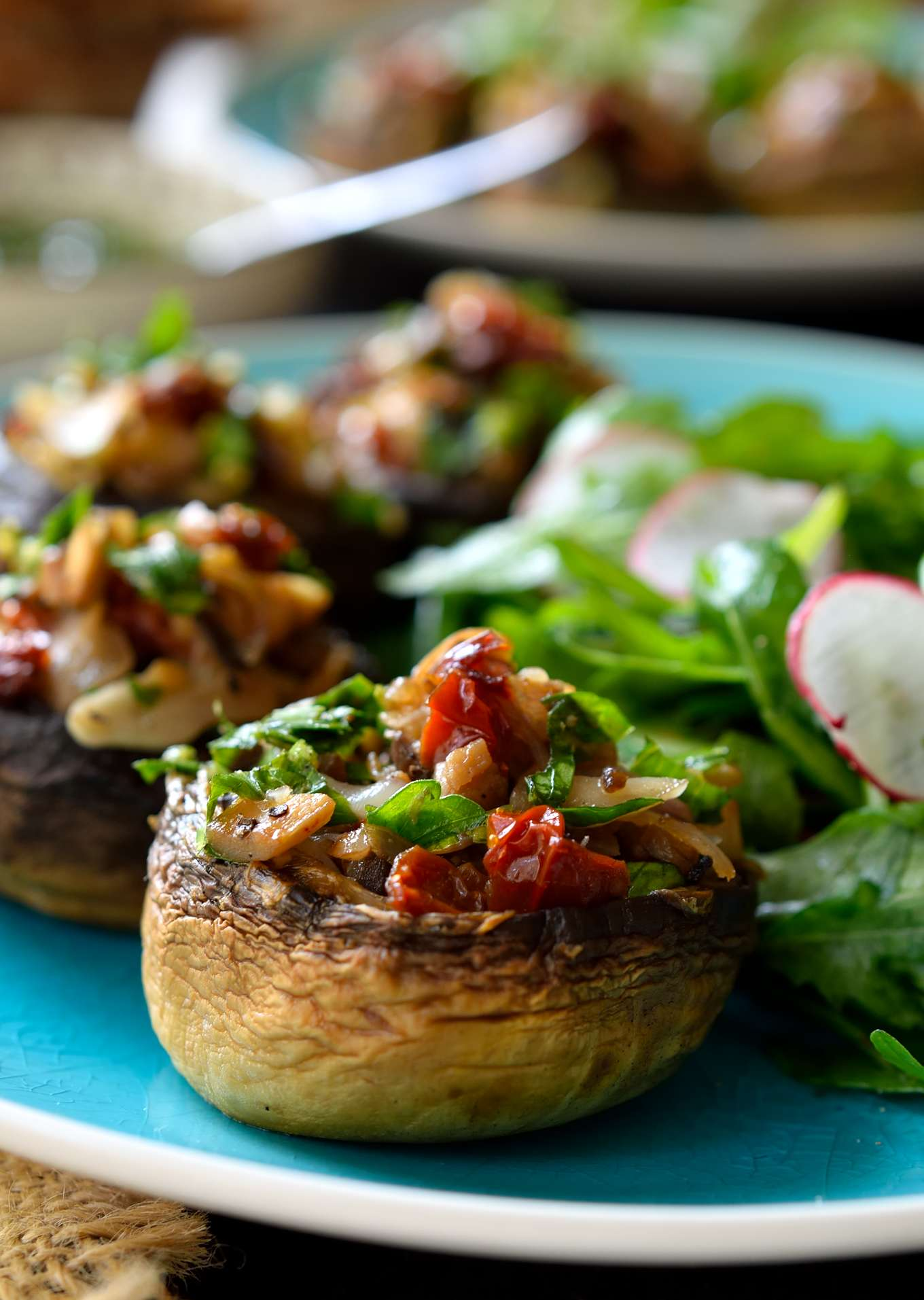 Vegan stuffed mushrooms are easy to make and packed with fresh herb-y, garlicky, citrus-y deliciousness. These little guys are great served as party finger food, a starter or a light main dish when paired with a fresh salad and crusty bread.