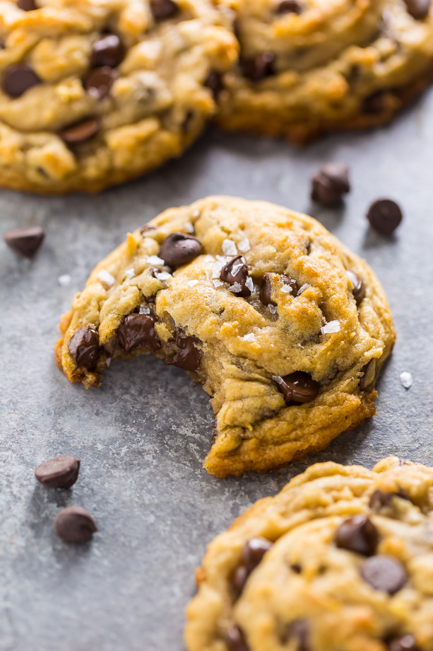These Vegan Chocolate Chip Cookies are thick, chewy, and loaded with gooey chocolate. No one will guess they're vegan!